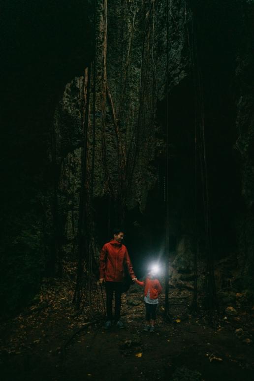Exploring one of many caves on Irabu Island, Japan