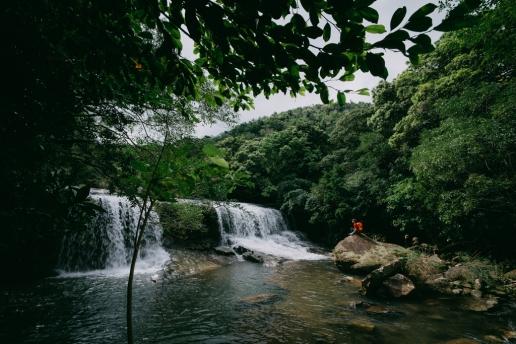 Admiring waterfalls of Iriomote, Yaeyama Islands, Okinawa, Japan