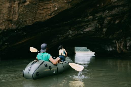 Packrafting through one of many sea caves of Tanegashima Island, Kagoshima, Japan