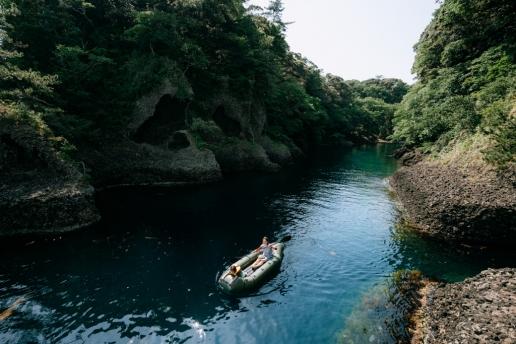 Kayaking through sea inlet of Sado Island, Niigata, Japan