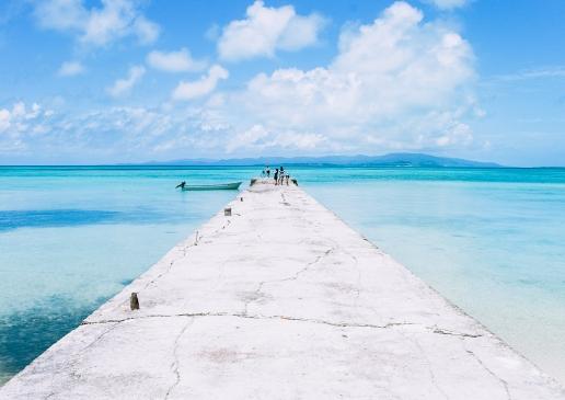 Nishi-Sanbashi Pier with clear blue tropical water of Taketomi, Yaeyama Islands, Okinawa