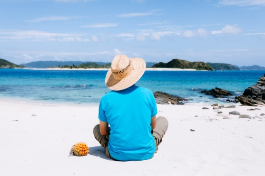Enjoying idyllic white sand beach of Tropical Japan, Kerama Islands, Okinawa