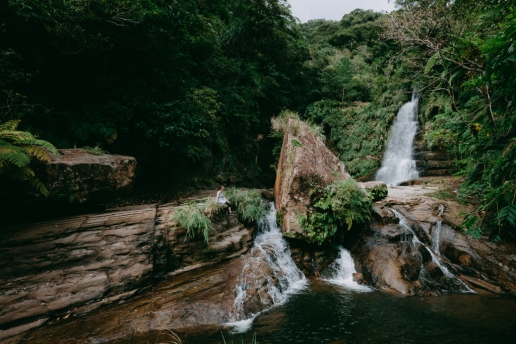 Lush waterfall deep inside a tropical rainforest of Iriomote, Japan
