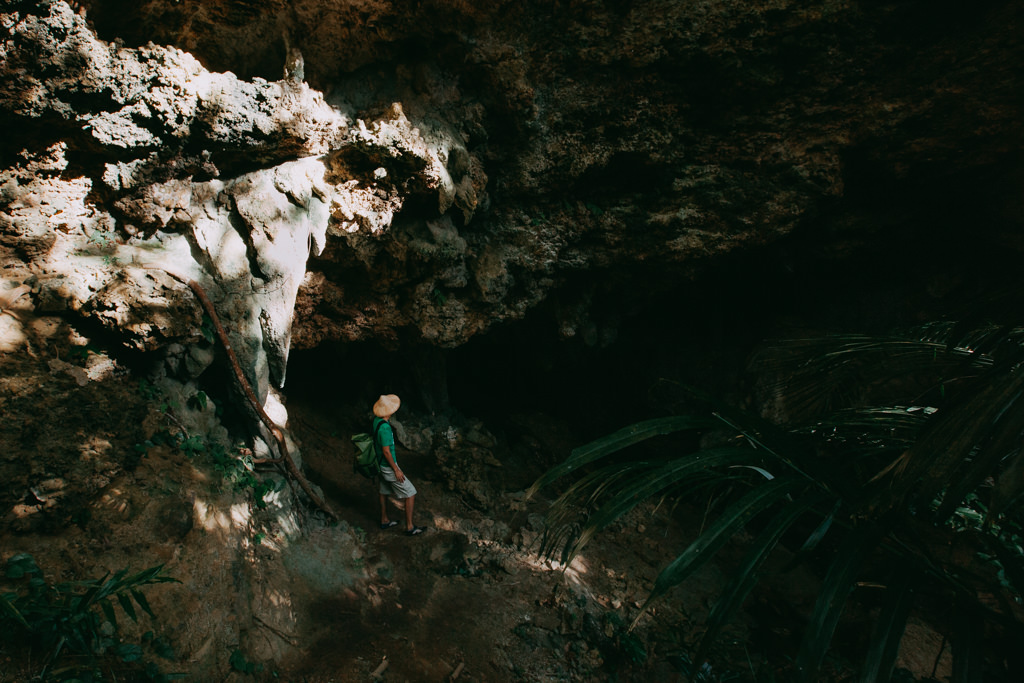 Exploring a limestone cave in jungle of Iriomote Island, Japan