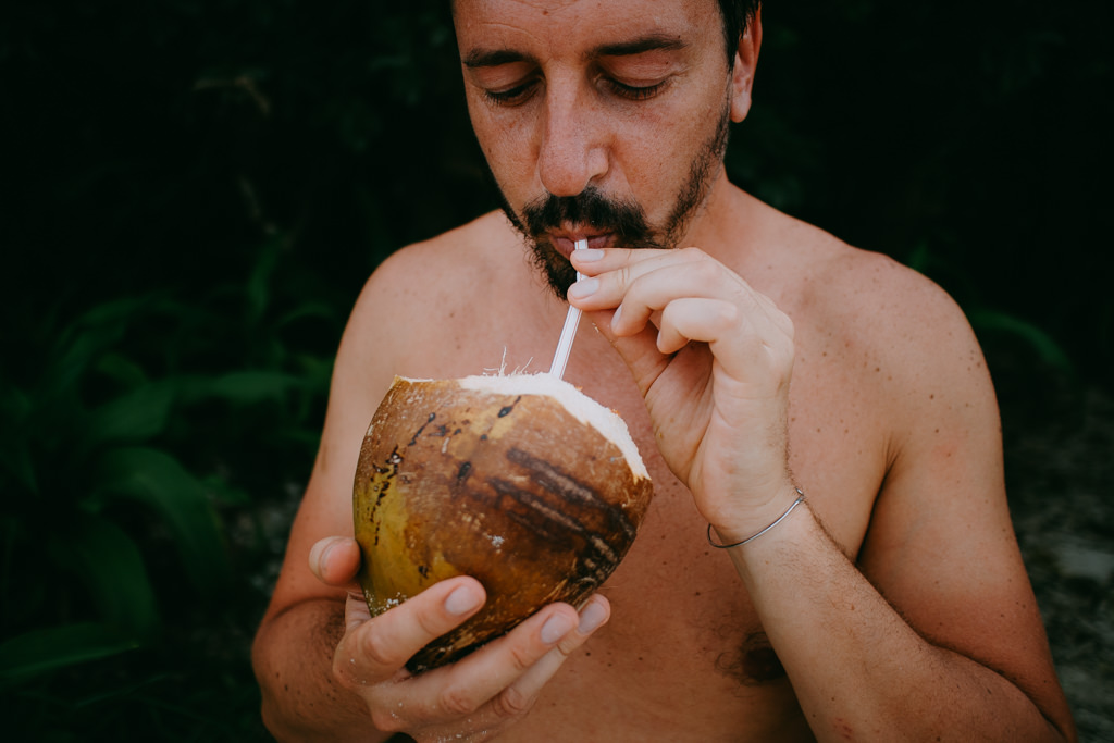 Drinking wild Japanese coconut juice, Ishigaki Island, Tropical Japan