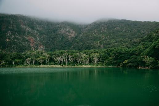 Miyake-jima crater lake with lush green forest, Tokyo